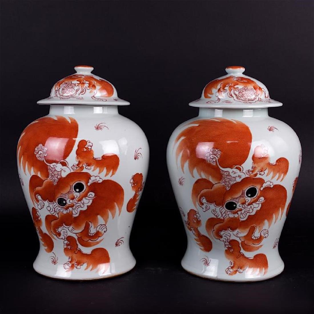 ANTIQUE PAIR OF IRON RED GINGER VASES WITH LID