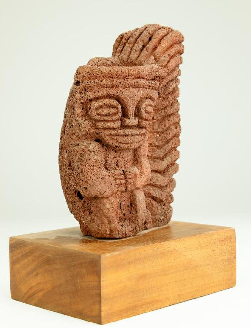 CARVED VOLCANIC ROCK OF A DEITY - 3