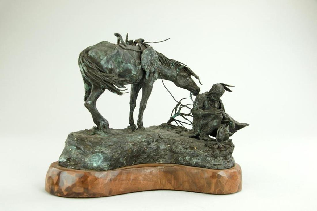 PATINATED BRONZE FIGURAL GROUP OF A MAN AND HORSE