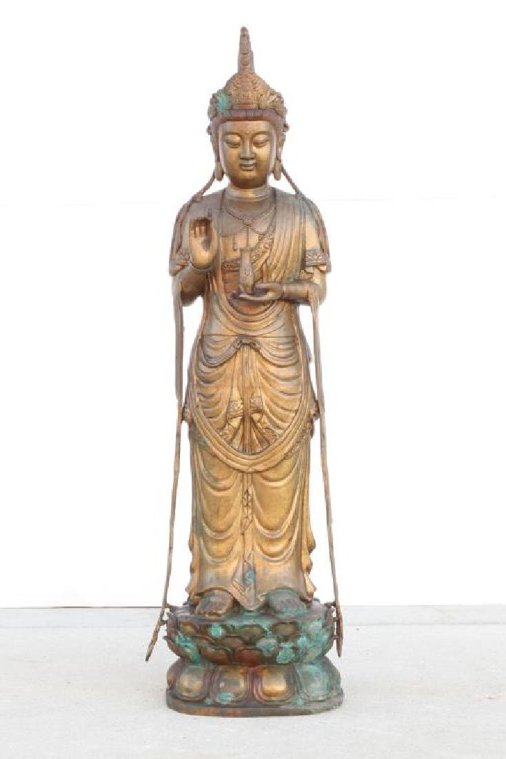 STANDING BRONZE GUAN YIN HOLDING A VASE OF NECTAR