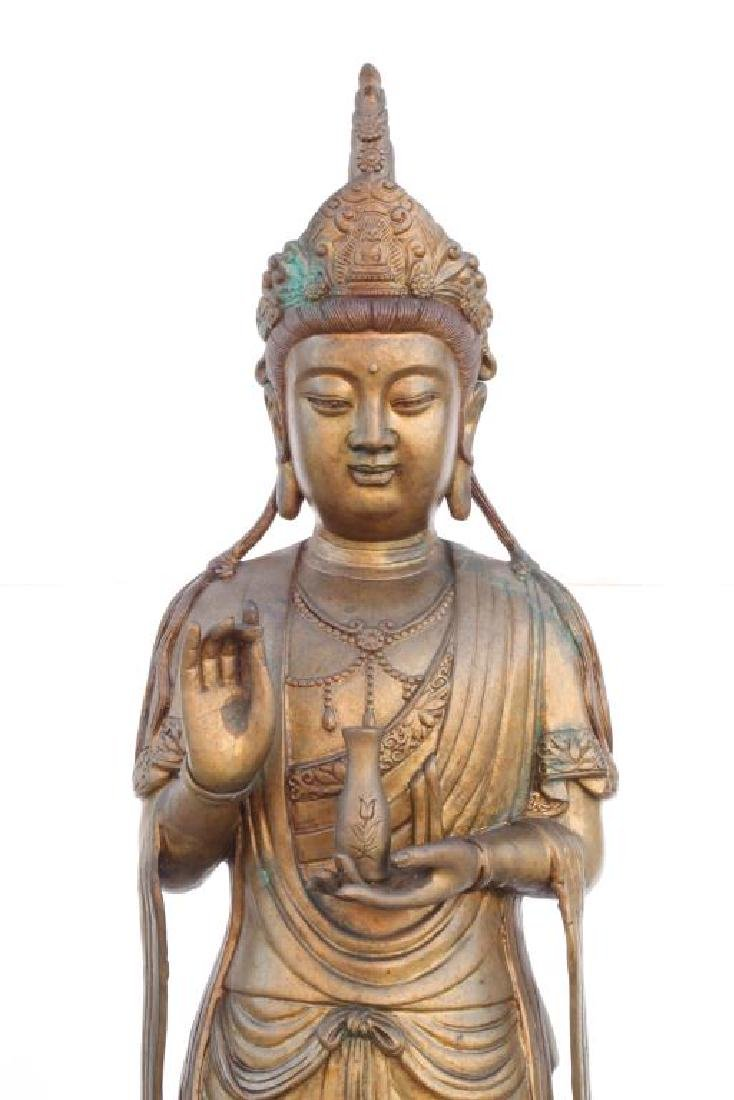STANDING BRONZE GUAN YIN HOLDING A VASE OF NECTAR - 2