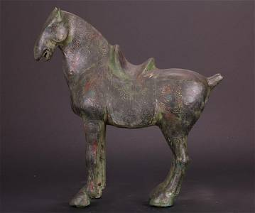 BRONZE STATUE OF A HORSE WITH GOLD INLAY