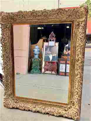 LARGE CARVED GILT FRAMED MIRROR WITH RUST FINISH