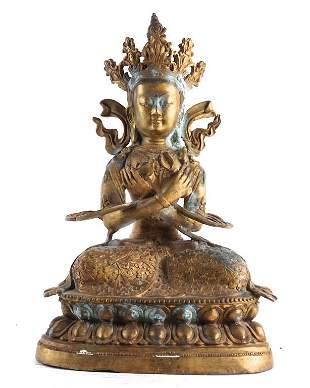 A GILT BRONZE FIGURE OF A TIBETAN BUDDHA