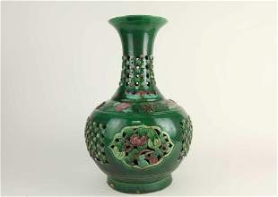 CHINESE GREEN GLAZED RETICULATED BOTTLE VASE