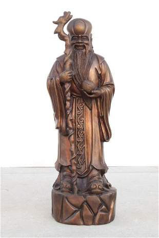 CHINESE CARVED BRONZE FIGURE OF 'SHOU'