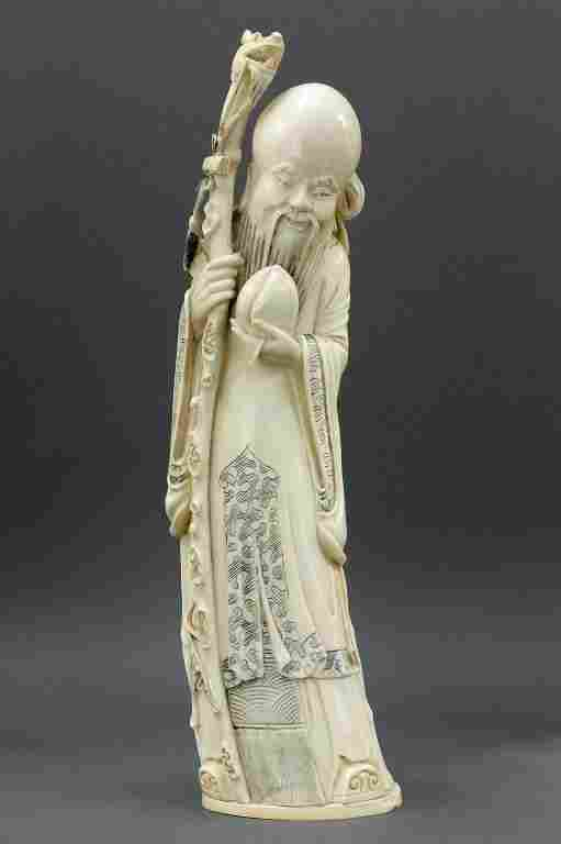 CHINESE CARVED IVORY FIGURE, OF IMMORTAL SAU