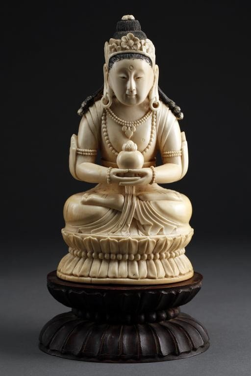 2: CHINESE CARVED IVORY OF A BUDDHA ON A LOTUS POD