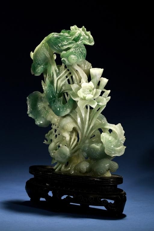 196: CHINESE CARVED JADEITE ON A ZITAN WOOD STAND