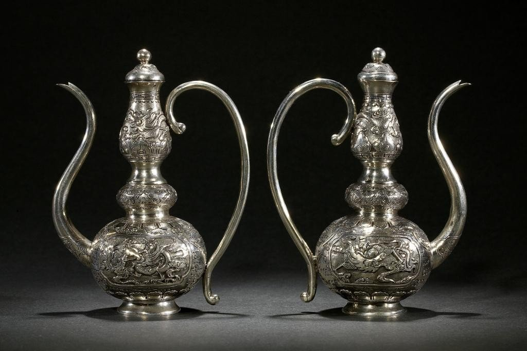 15: PAIR OF CHINESE MINIATURE SILVER EWERS