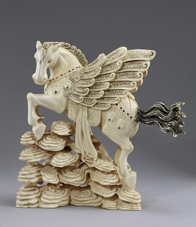 23: CHINESE BEJEWELLED IVORY CARVING OF A PEGASUS