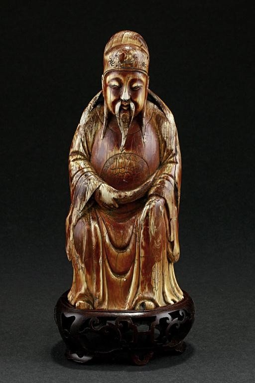 1A: ANTIQUE CHINESE CARVED IVORY OF A BEARDED SCHOLAR