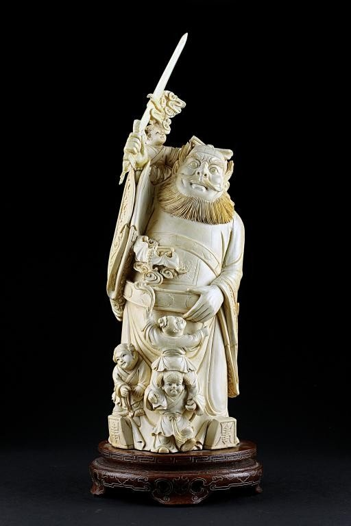 4: CARVED CHINESE IVORY FIGURE OF A GUARDIAN