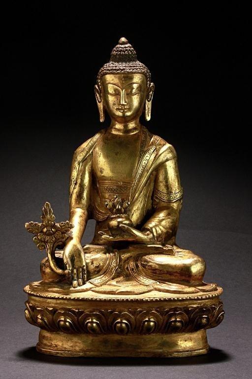 10: ANTIQUE TIBETAN GILT BRONZE FIGURE OF A BUDDHA