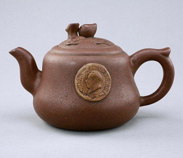 23: CHINESE CLAY TEAPOT EMBOSSED WITH MAO TSE TUNG PROF