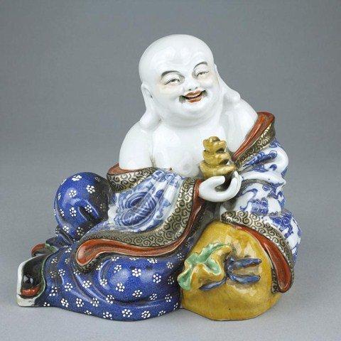 CHINESE PORCELAIN FIGURE  OF A BUDDHA