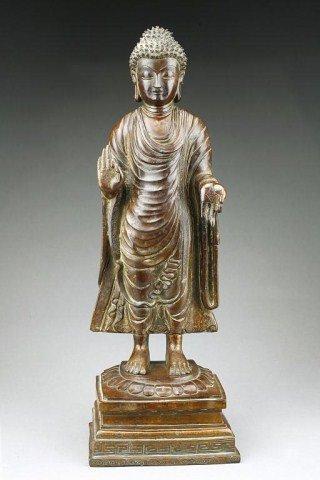 MING DYNASTY BRONZE FIGURE OF A STANDING BUDDHA