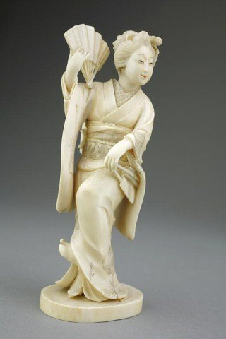 JAPANESE IVORY OKIMONO, OF A GEISHA