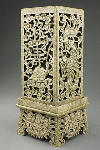 CHINESE CARVED STONE RETICULATED CANDLE STAND