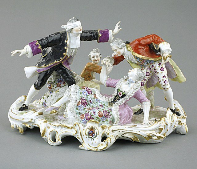 PORCELAIN FIGURAL GROUP OF ADULTS PLAYING