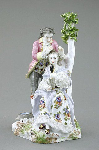 PORCELAIN FIGURE OF LOVERS BY A TREE