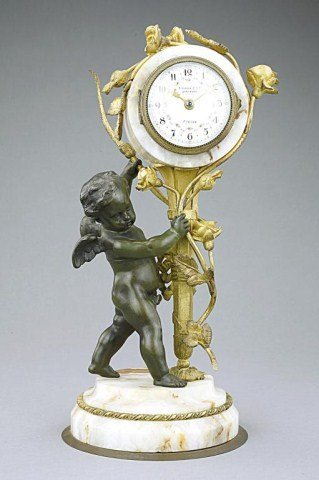 FRENCH PATINATED AND GILT-BRONZE MANTEL CLOCK