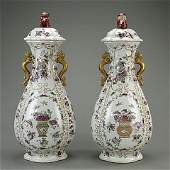 PAIR OF CHINESE FAMILLE ROSE LIDDED JARS