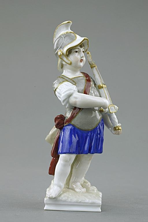 PORCELAIN FIGURE OF A BOY DRESSED AS A SOLDIER