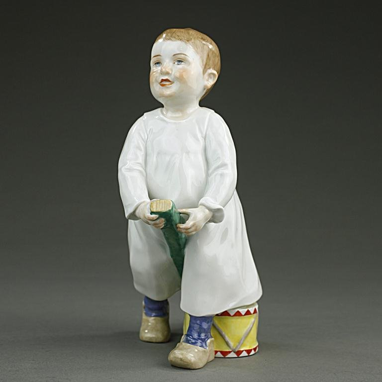 MEISSEN PORCELAIN FIGURE OF A YOUNG BOY PLAYING HORSE