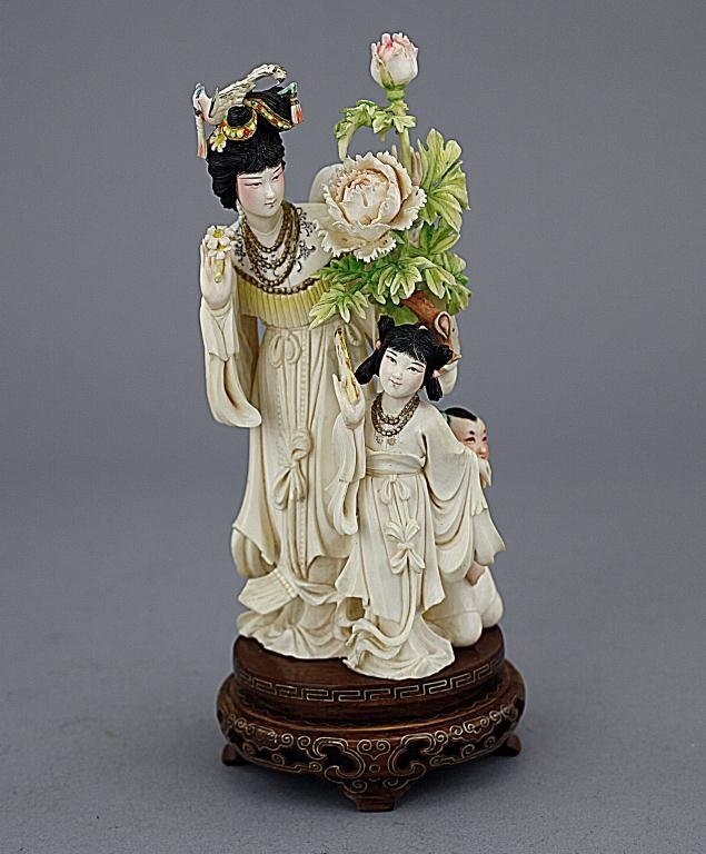 CHINESE POLYCHROMED IVORY FIGURE OF A BEAUTY