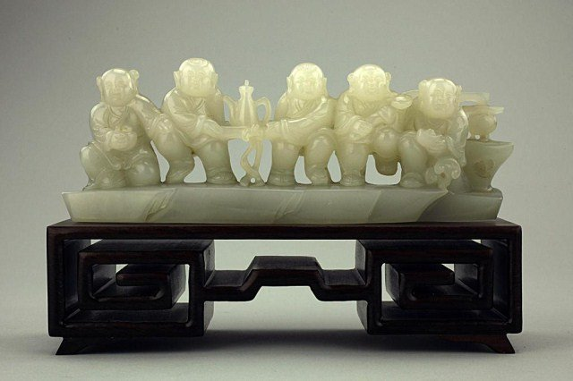 WHITE HETIAN JADE FIGURAL CARVING OF FIVE BOYS