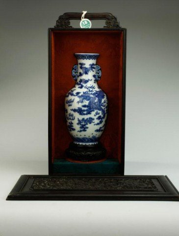 CHINESE BLUE AND WHITE VASE WITH WOODEN STAND
