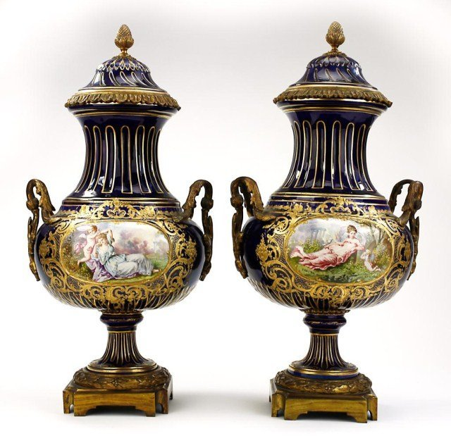 PAIR OF HAND-PAINTED SEVRES PORCELAIN URNS AND COVERS