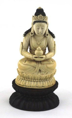 CHINESE CARVED IVORY FIGURE OF A SEATED GUANYIN