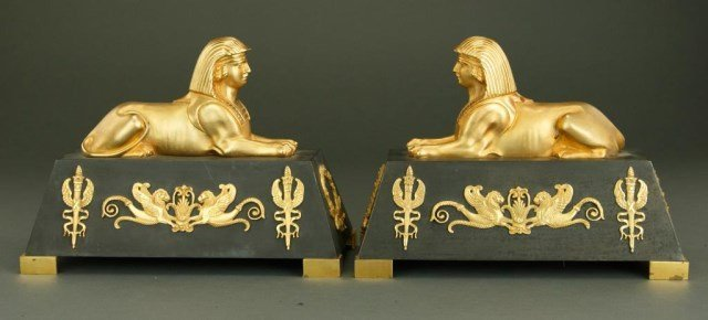 PAIR OF BRONZE CHENETS WITH SPHINXES
