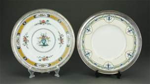 TWO ANTIQUE PORCELAIN PLATES WITH SILVER RIMS