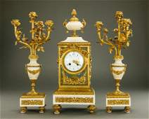 FRENCH GILT BRONZE AND WHITE MARBLE CLOCK SET