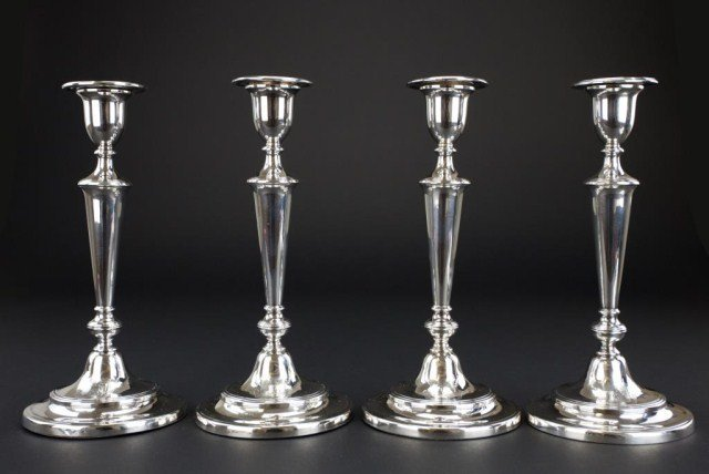 SET OF FOUR GEORGIAN STERLING SILVER CANDLESTICKS