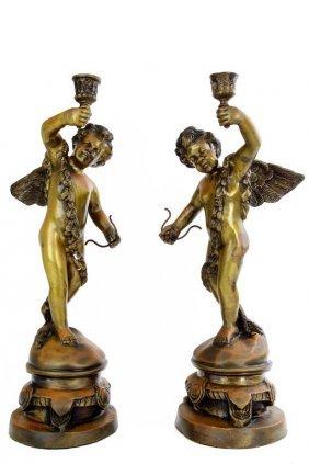 Pair Of Bronze Cherub Candle Holders