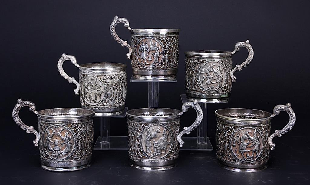 SIX RETICULATED PERSIAN SILVER CUP HOLDERS