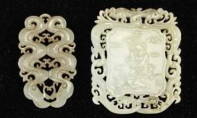 TWO CARVED CHINESE JADE PENDANTS