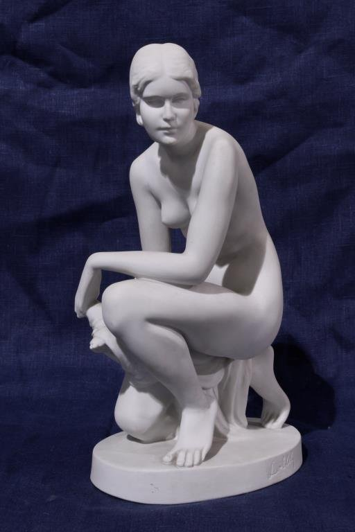 WHITE POTTERY FIGURE OF A NAKED BEAUTY