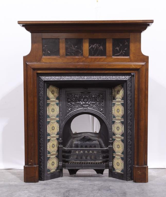 SMALL INLAID WOOD CORNER WITH CAST IRON FIREPLACE