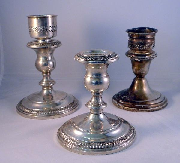 16: A PAIR OF FISHER STERLING SILVER CANDLESTICKS toget