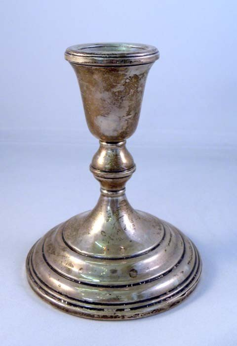 17: A LUNT STERLING SILVER CANDLESTICK with weighted ba
