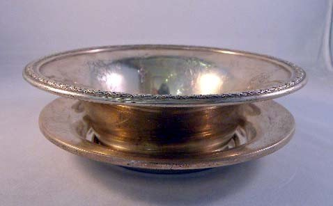 24: A LOUIS XIV STERLING SILVER BOWL with floral edge d