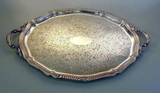 30: A STERLING SILVER SERVING TRAY WITH HANDLES a centr