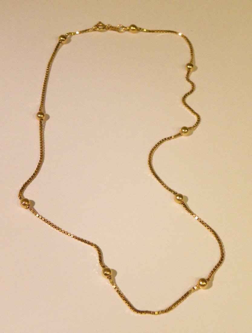 18k Yellow gold chain with floating gold balls