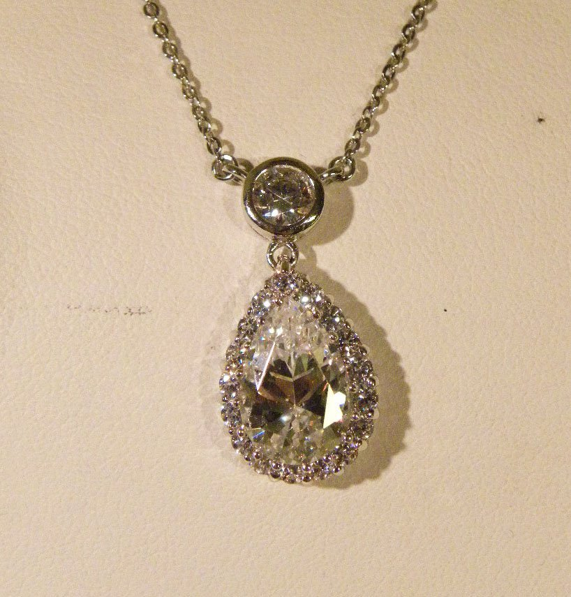 Lg. pear CZ & floating CZ's Sterling necklace