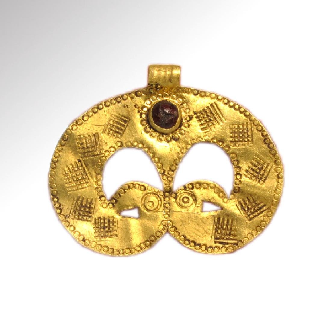 Migration Period Gold Pendant with Bird-Head